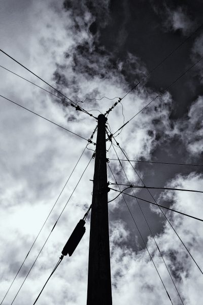 power lines with clouds behind them