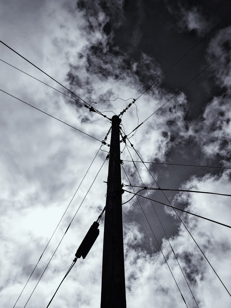 powerlines with clouds in the background